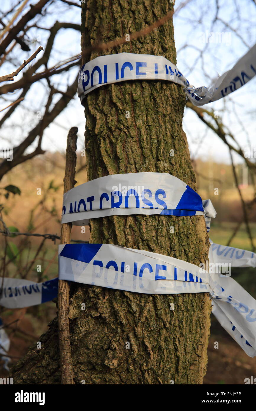 A 'don't cross' police line, at a crime scene, in the countryside in England, UK - Stock Image