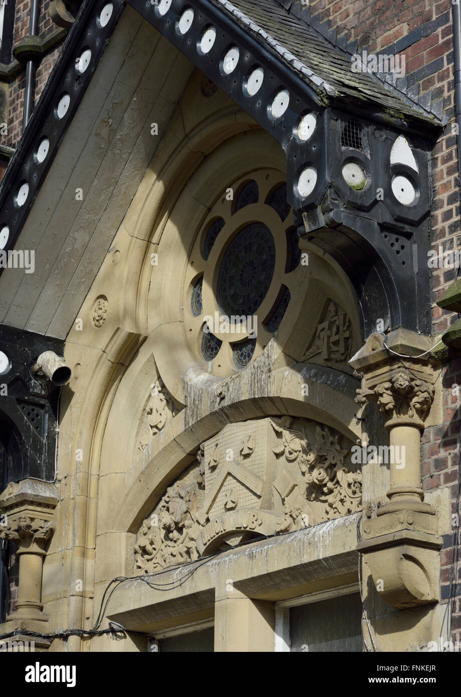 Ornamental stonework stained by pigeon droppings in bury lancashire - Stock Image