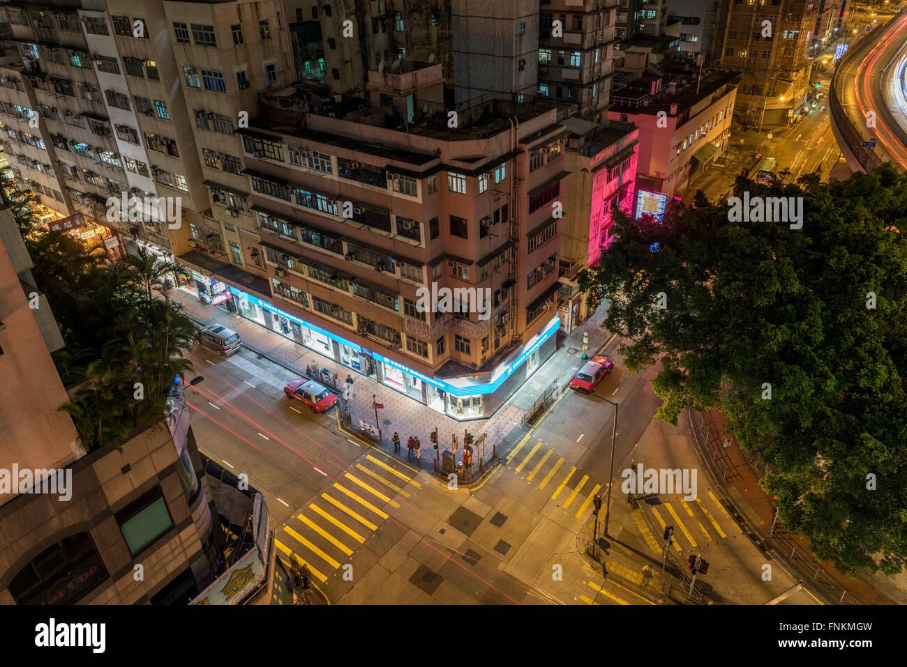 HONG KONG , CHINA - 15 MAR 2016: Street crossing at night on March 15, 2012 in Hong Kong, China. Hong Kong have - Stock Image