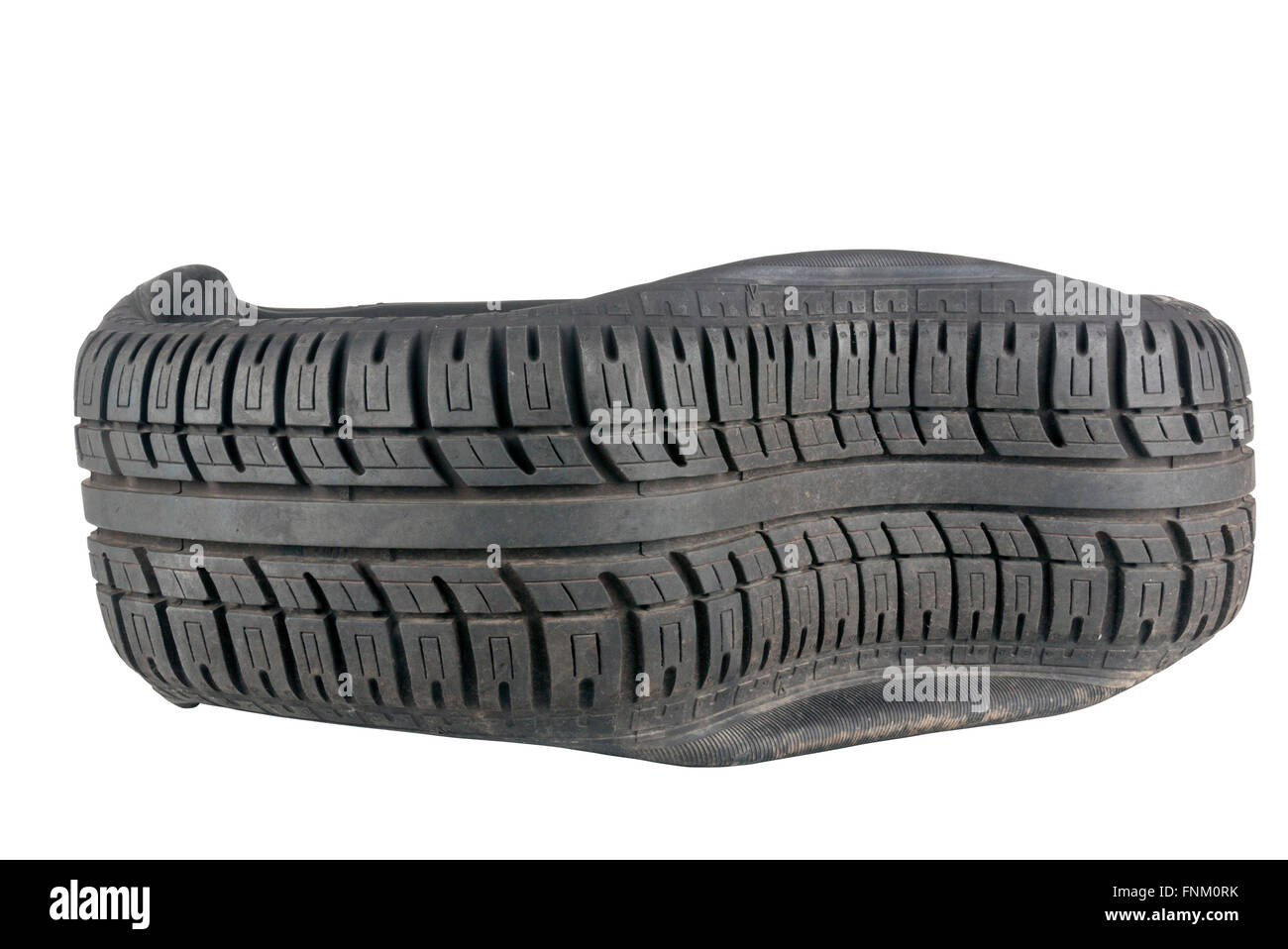 isolated closeup of irregular pattern in tread on tire after a blowout - Stock Image