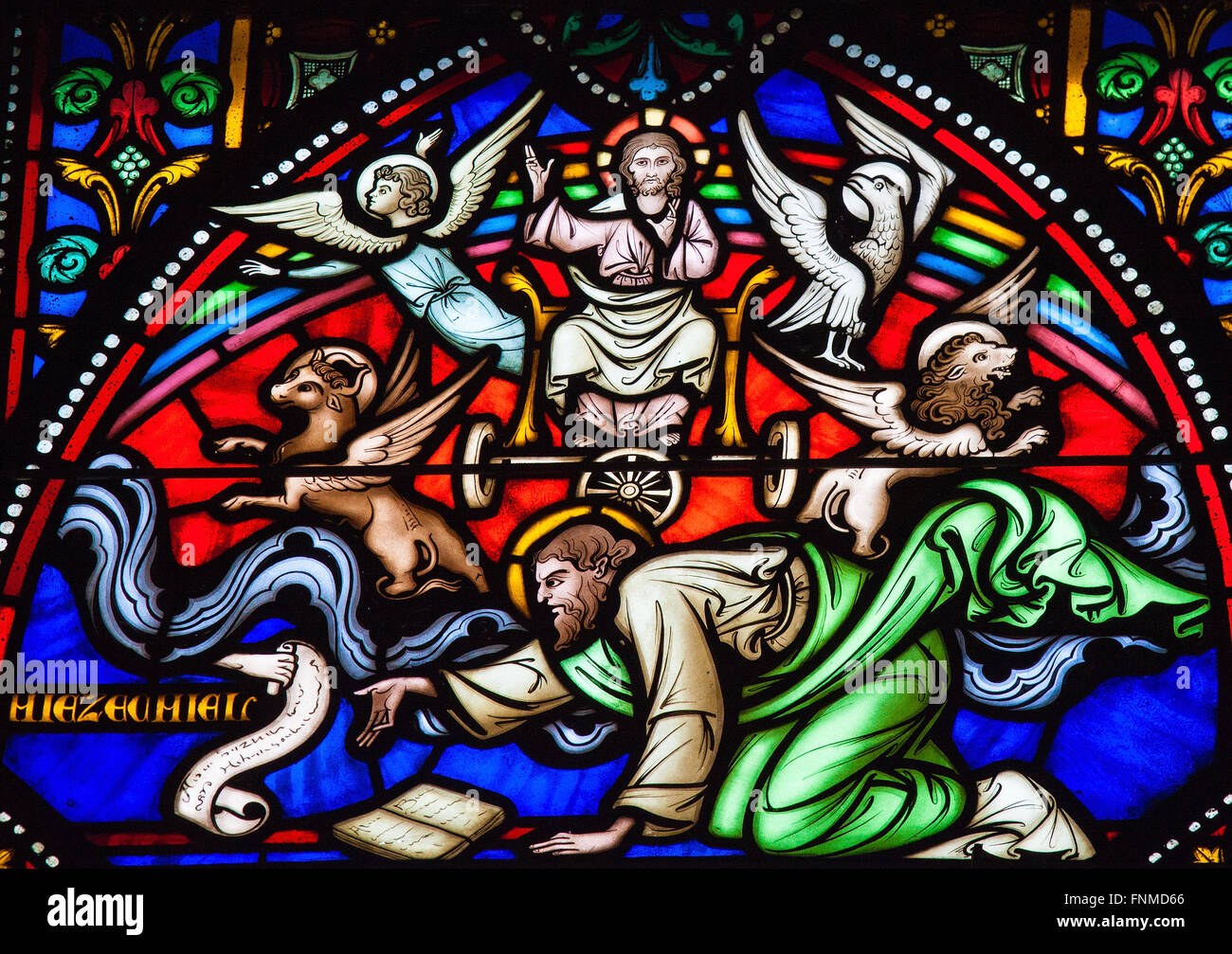 Stained glass window depicting Cherubim and Chariot vision of the Prophet Ezekiel in the cathedral of Brussels. - Stock Image