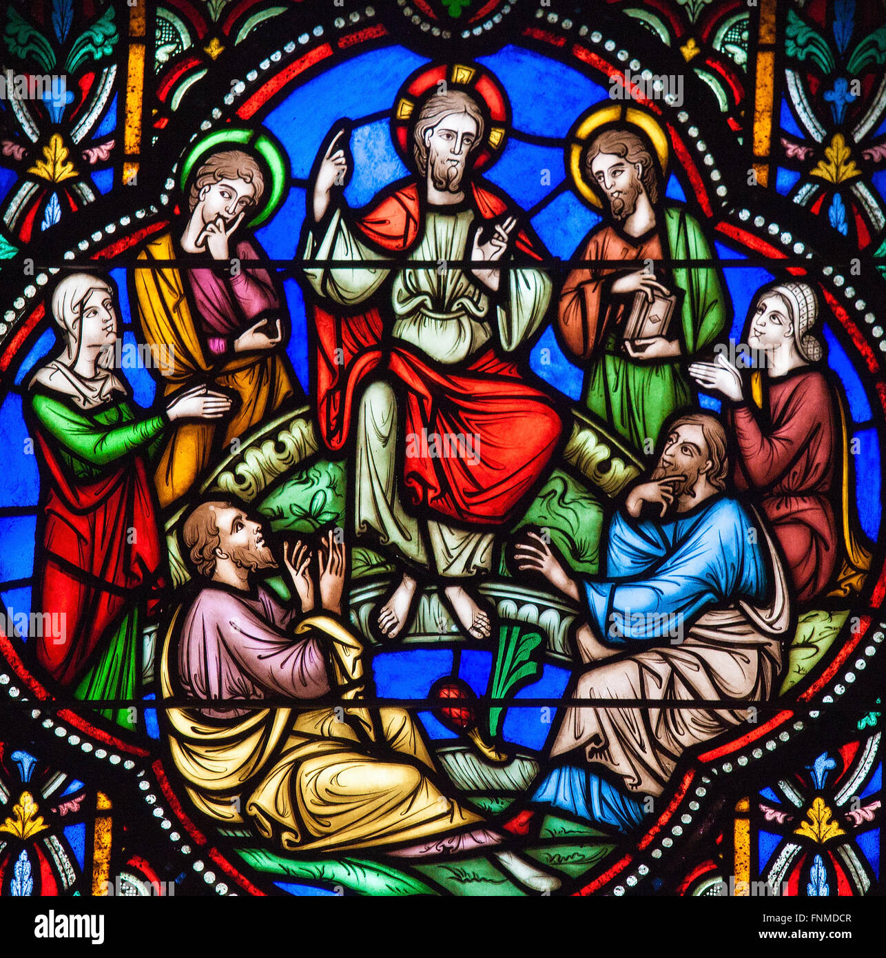 stained glass window depicting jesus and the sermon on the