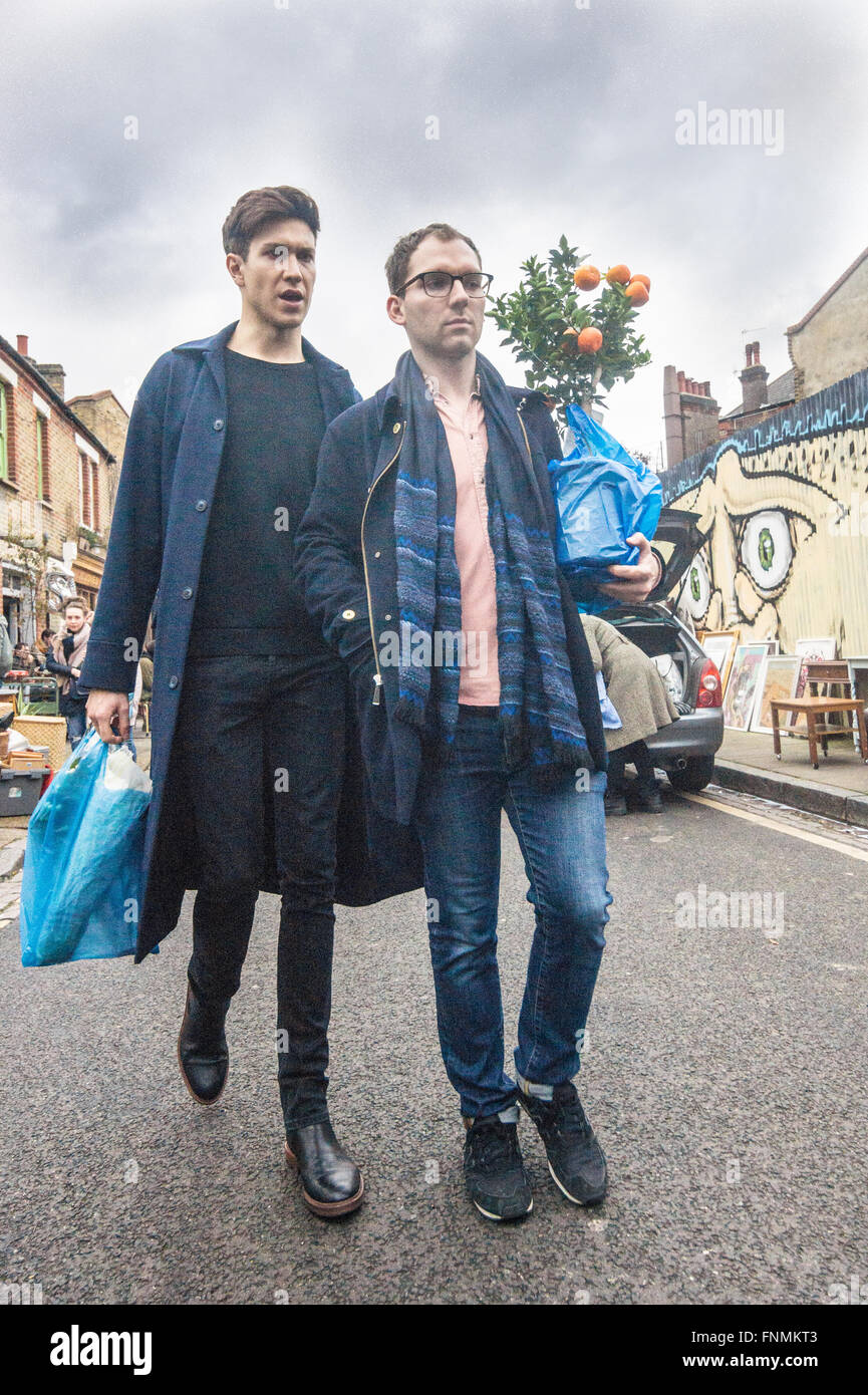 gay couple shopping  columbia road London - Stock Image