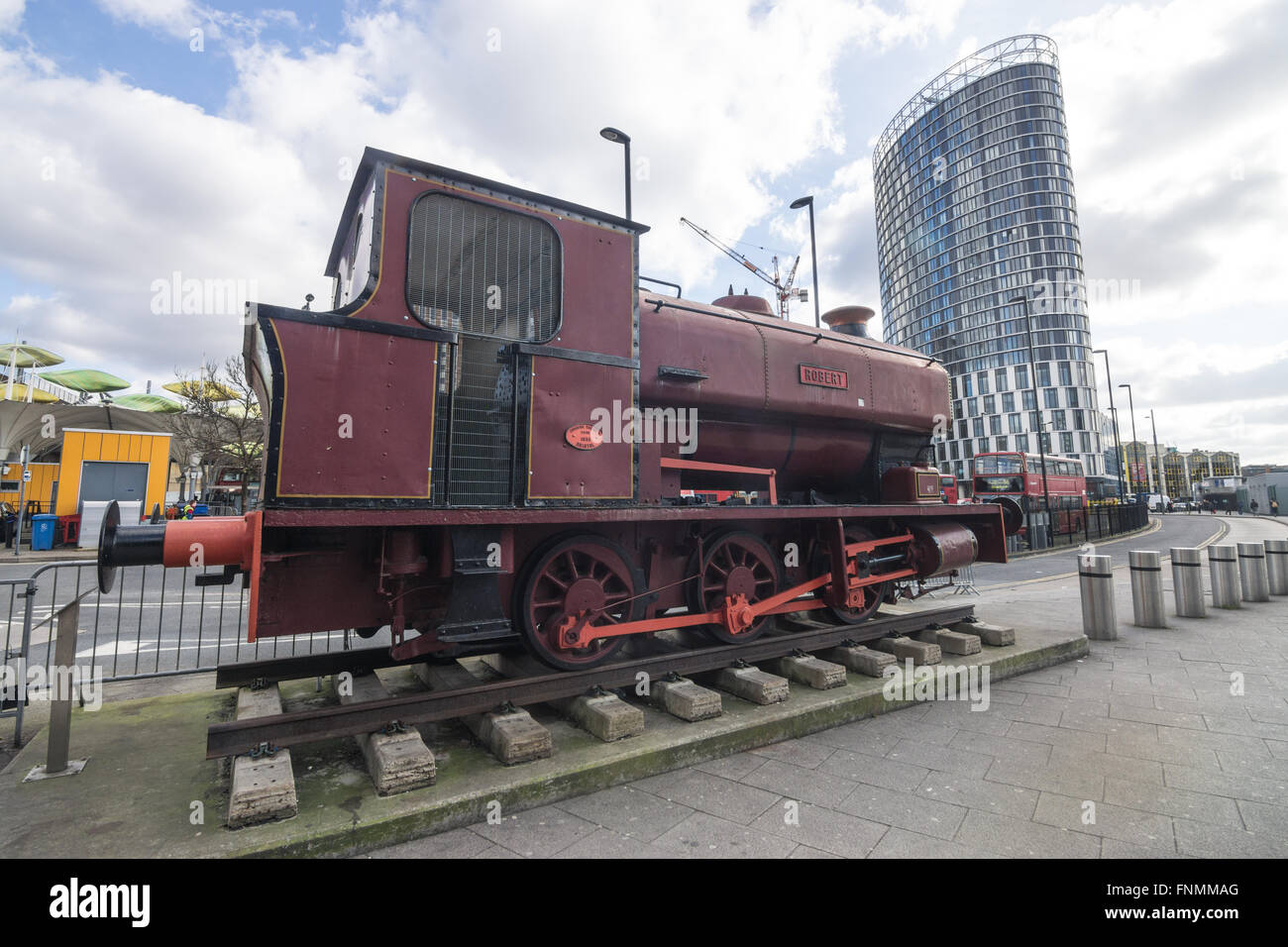 shunting locomotive ROBERT outside the entrance to Stratford Station. - Stock Image