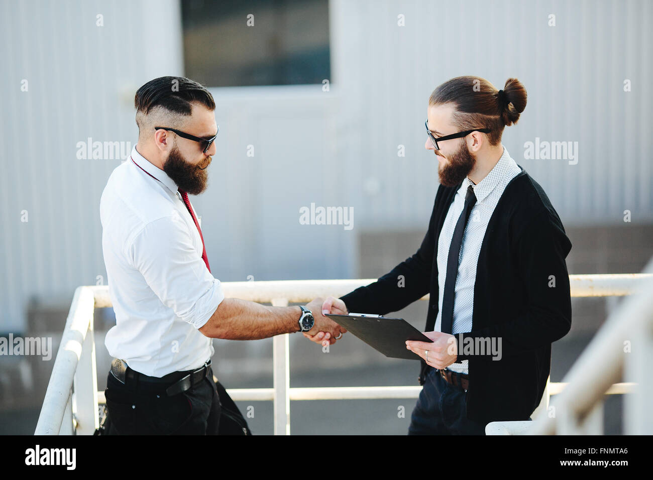 Two businessmen shaking hands - Stock Image