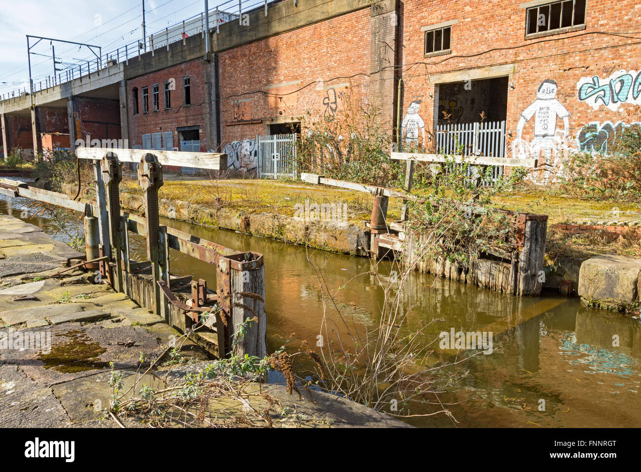 Derelict lock gates on Hulme Locks Junction Canal, St. Georges Island, Manchester, England, UK - Stock Image
