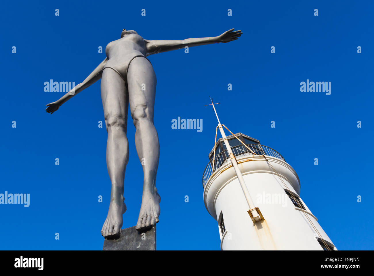 Scarborough lighthouse and diving belle sculpture, UK - Stock Image