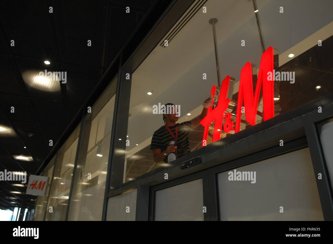 Logo sign of H & M Hennes & Mauritz  a Swedish multinational retail-clothing company - Stock Image