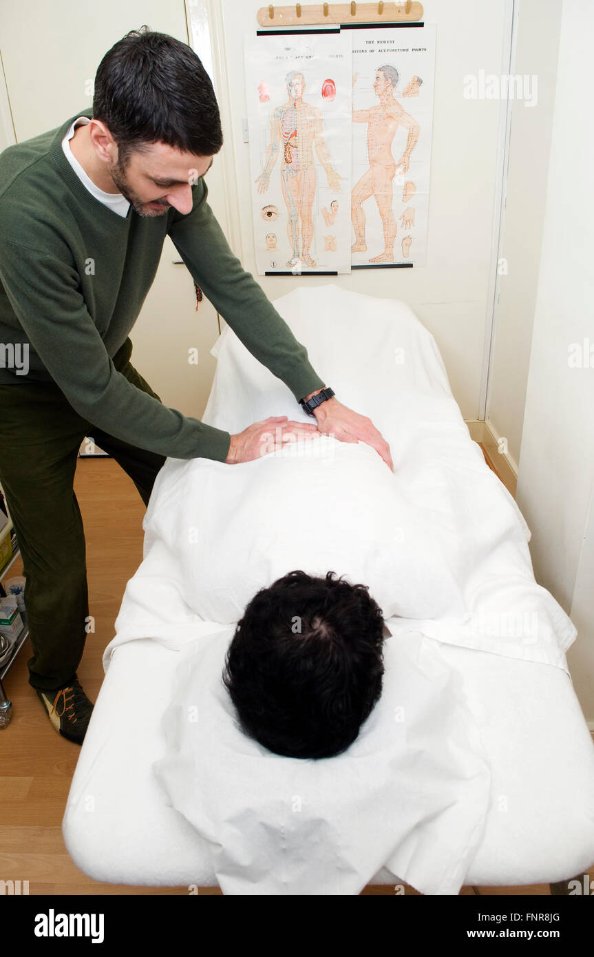 Wrapping patients in lots of blankets to help them sweat is an important part of acupuncture treatment for body - Stock Image