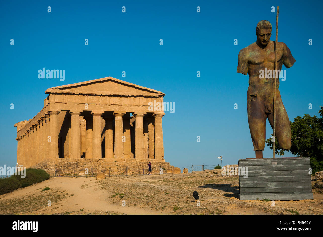 Daedalus, bronze sculpture by Igor Mitoraj. In the background the Temple of Concordia. Valley of the Temples. Agrigento. - Stock Image