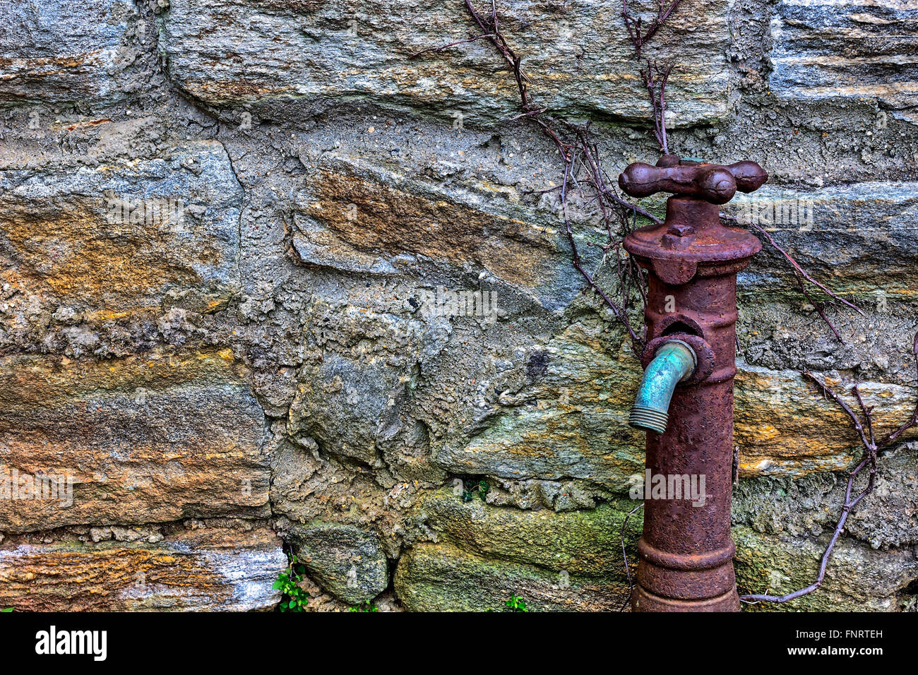 Old Rusty Water Faucet on side of building Stock Photo: 99483737 - Alamy