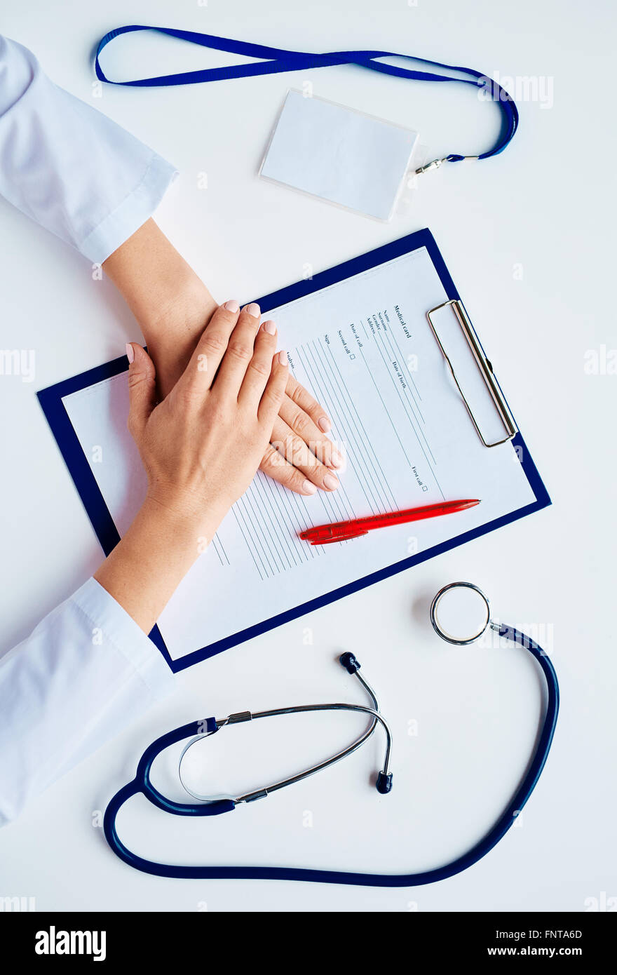 Doctor hands on medical card during work - Stock Image