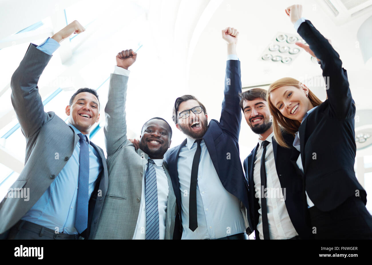 Business team raising hands and expressing triumph Stock Photo