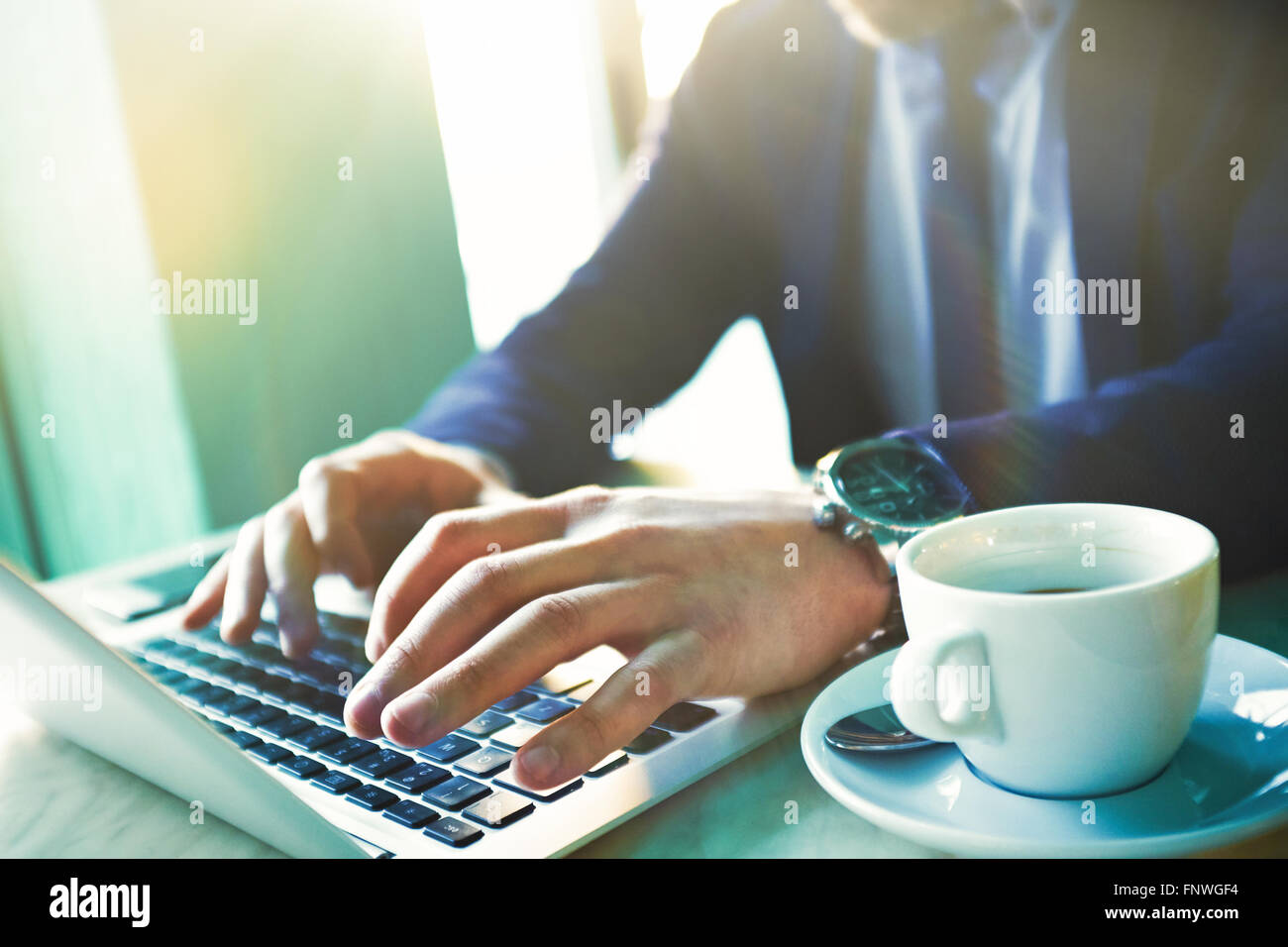 Hands of businessman typing on laptop Stock Photo