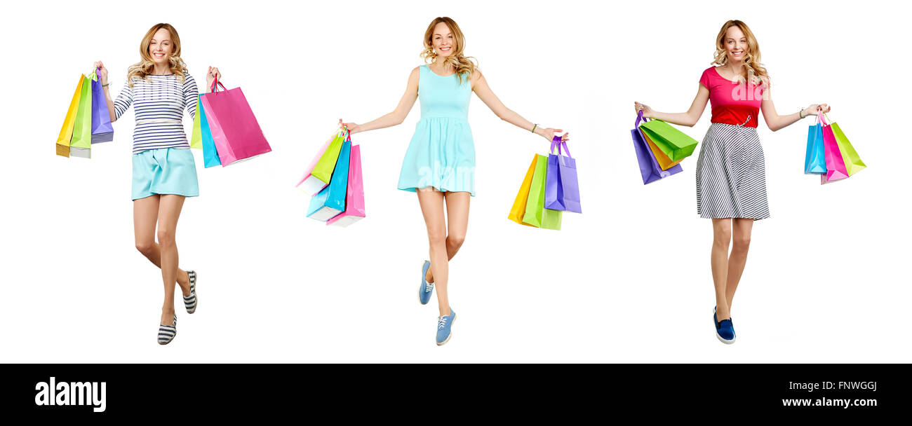 Pretty young shopper with paperbags expressing satisfaction - Stock Image