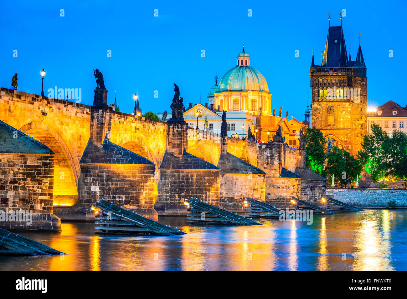 Prague, Czech Republic. Night view with Vltava River, Charles Bridge and Stare Mesto Old Town Tower. Twilight image - Stock Image