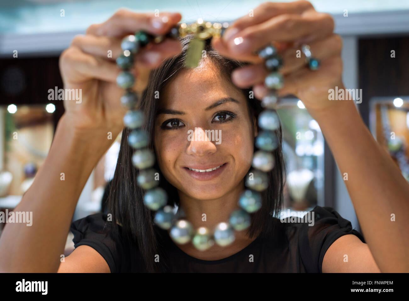 Woman seller in Tahia Exquisite Tahitian Pearls shop in Papeete, Tahiti, French Polynesia, Tahiti Nui, Society Islands, - Stock Image