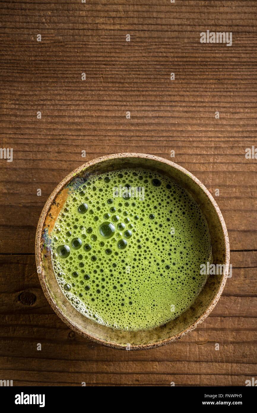 Matcha tea serving in matcha bowl - Stock Image