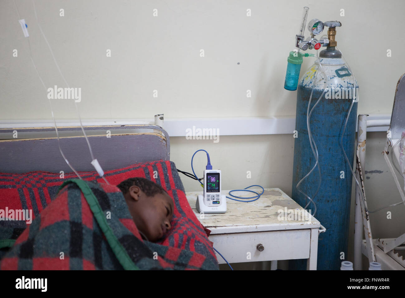 A young boy being monitored by a lifebox in  the Intensive-care unit, Addis Ababa, Ethiopia. - Stock Image