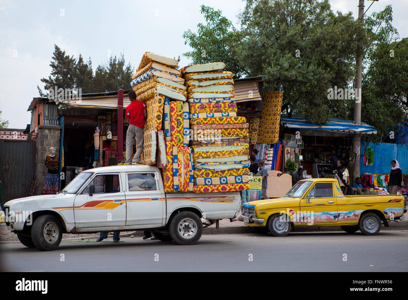 Mattresses piled high on the back of a pickup in Addis Ababa, Ethiopia. - Stock Image