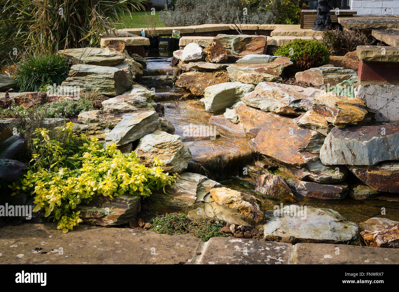A New Small Garden Water Feature Using Welsh Slate Rocks   Stock Image