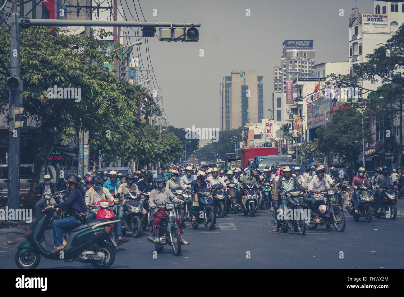 many scooter drivers , motorbike traffic , streets of saigon, vietnam - Stock Image