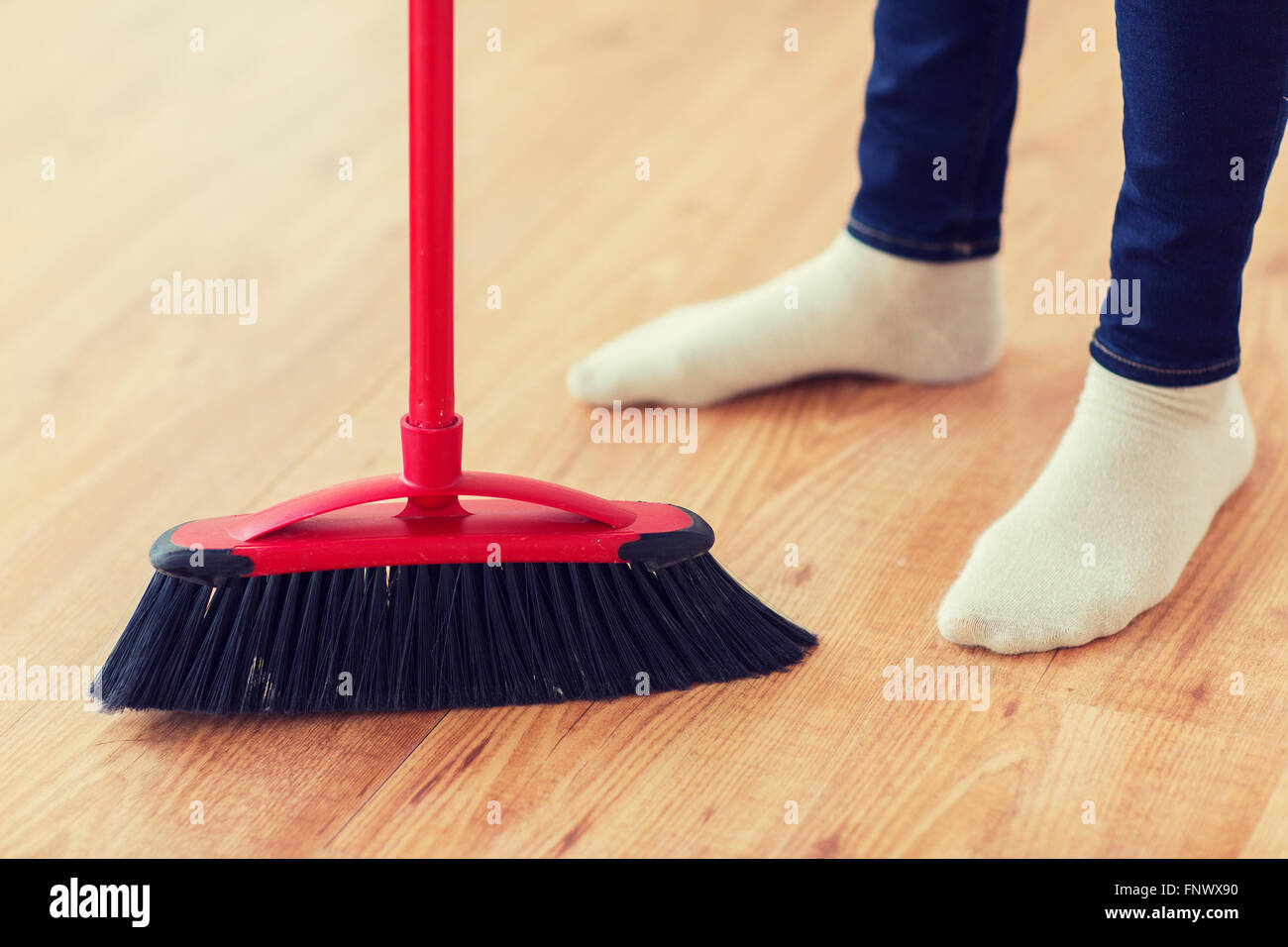 broom sweeping floor high resolution stock photography and images alamy https www alamy com stock photo close up of woman legs with broom sweeping floor 99529052 html