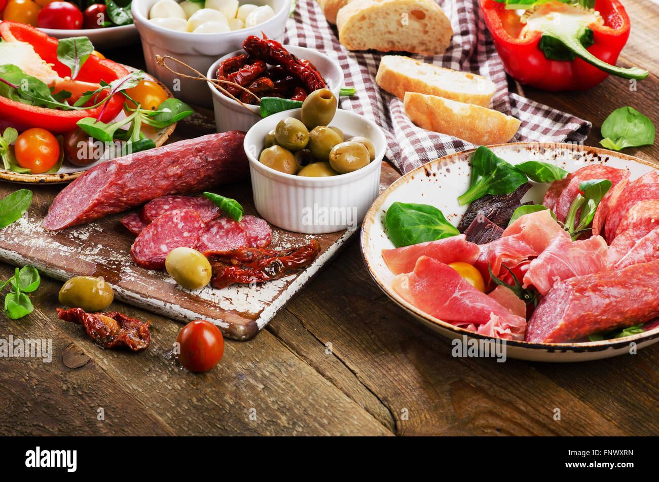 Appetizer set. Italian healthy food on wooden board. - Stock Image