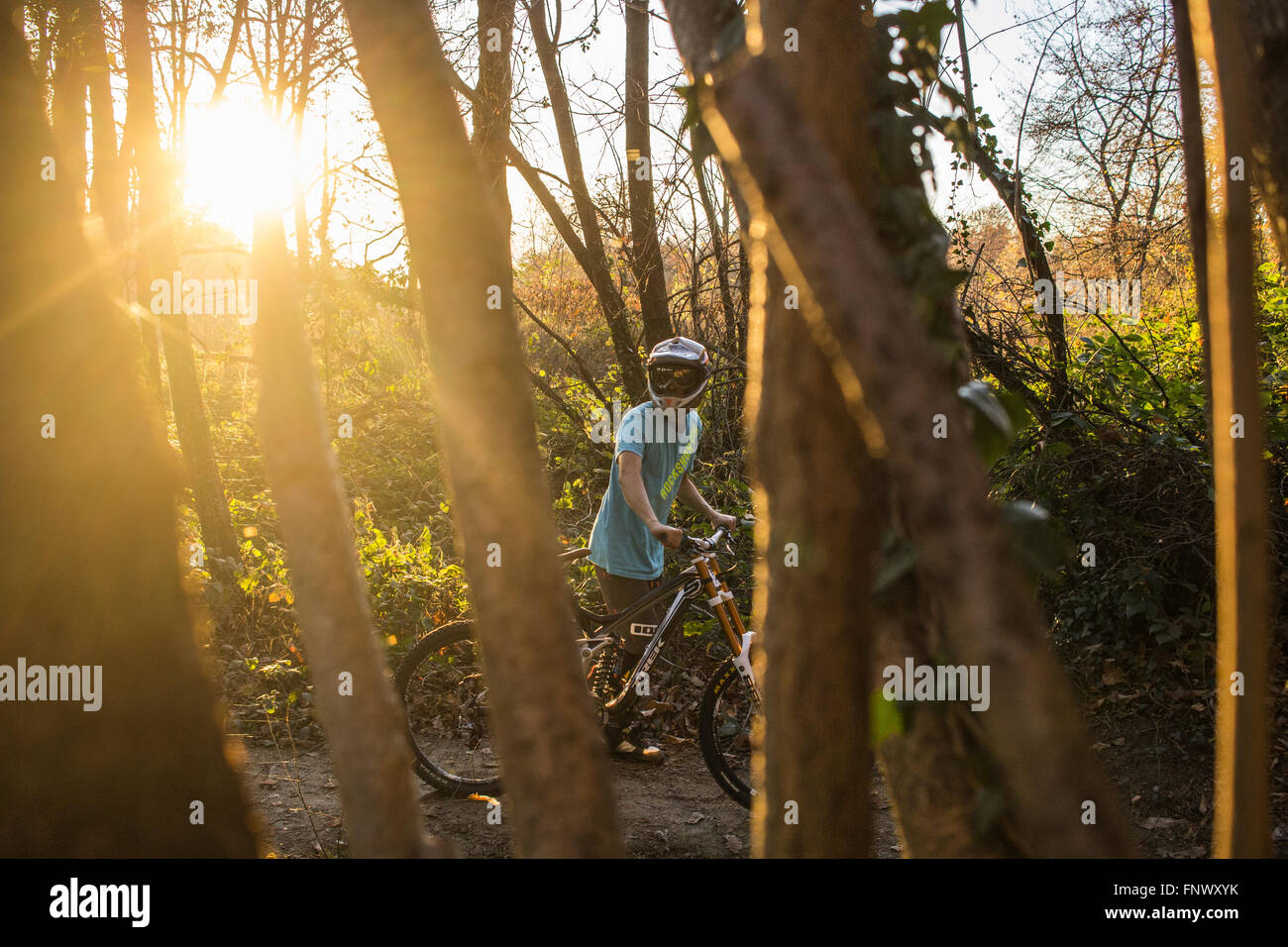 Boy riding Mountain Bike in Italy during an autumnal day. 2015. - Stock Image