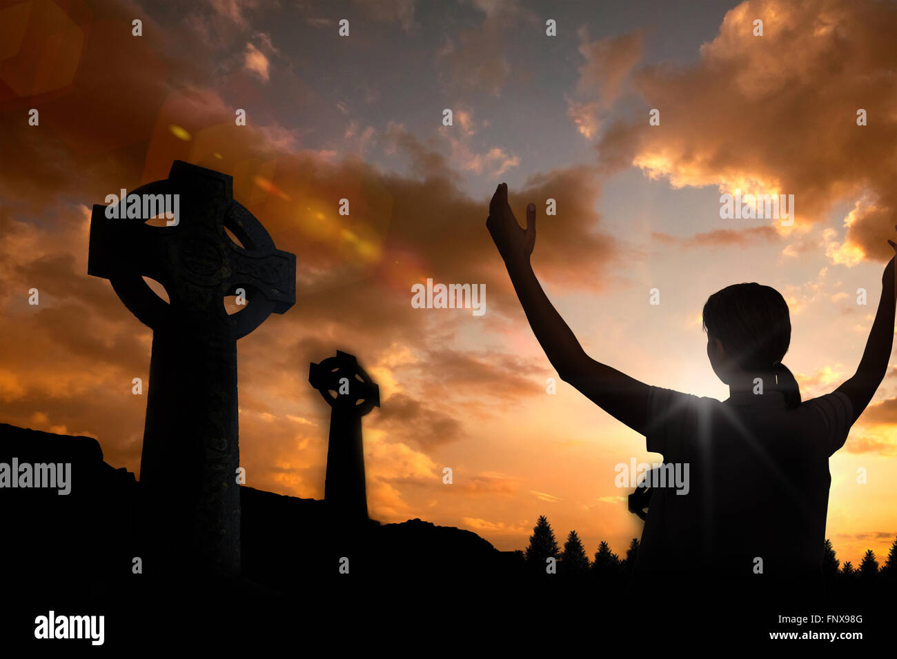 Composite image of woman in casuals with hands raised over white background - Stock Image