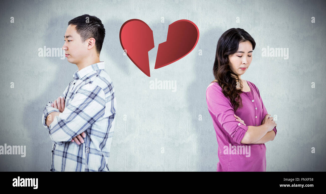 Composite image of upset couple standing with arms crossed - Stock Image