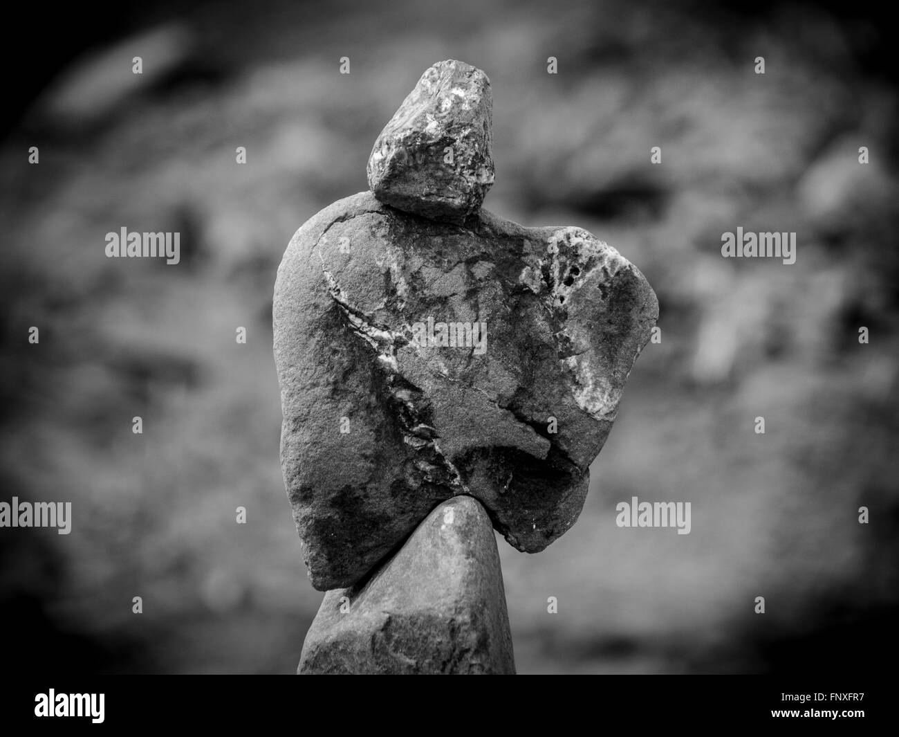 rock sculpture that looks like the grim reaper - Stock Image
