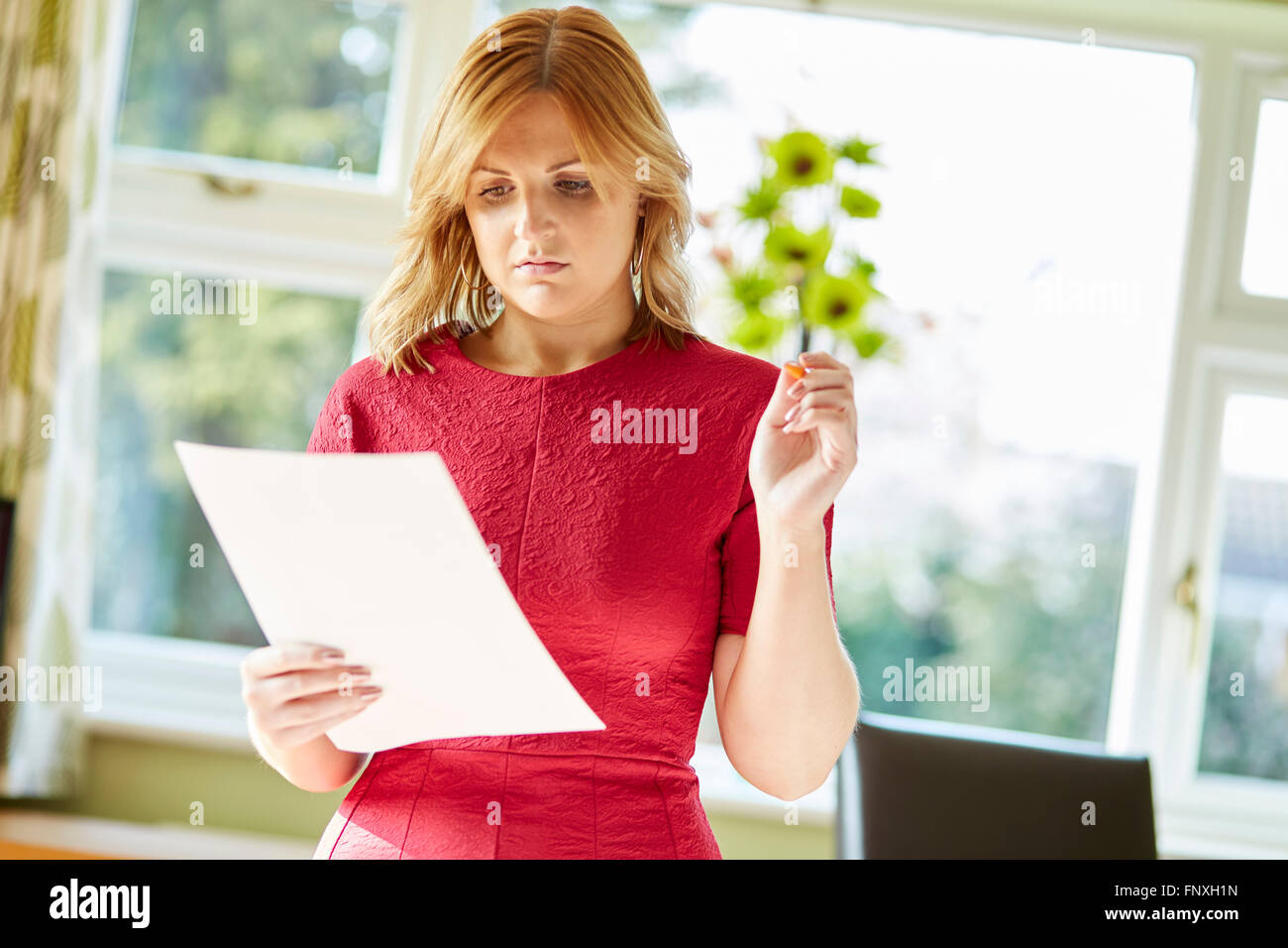 woman checking accounts - Stock Image