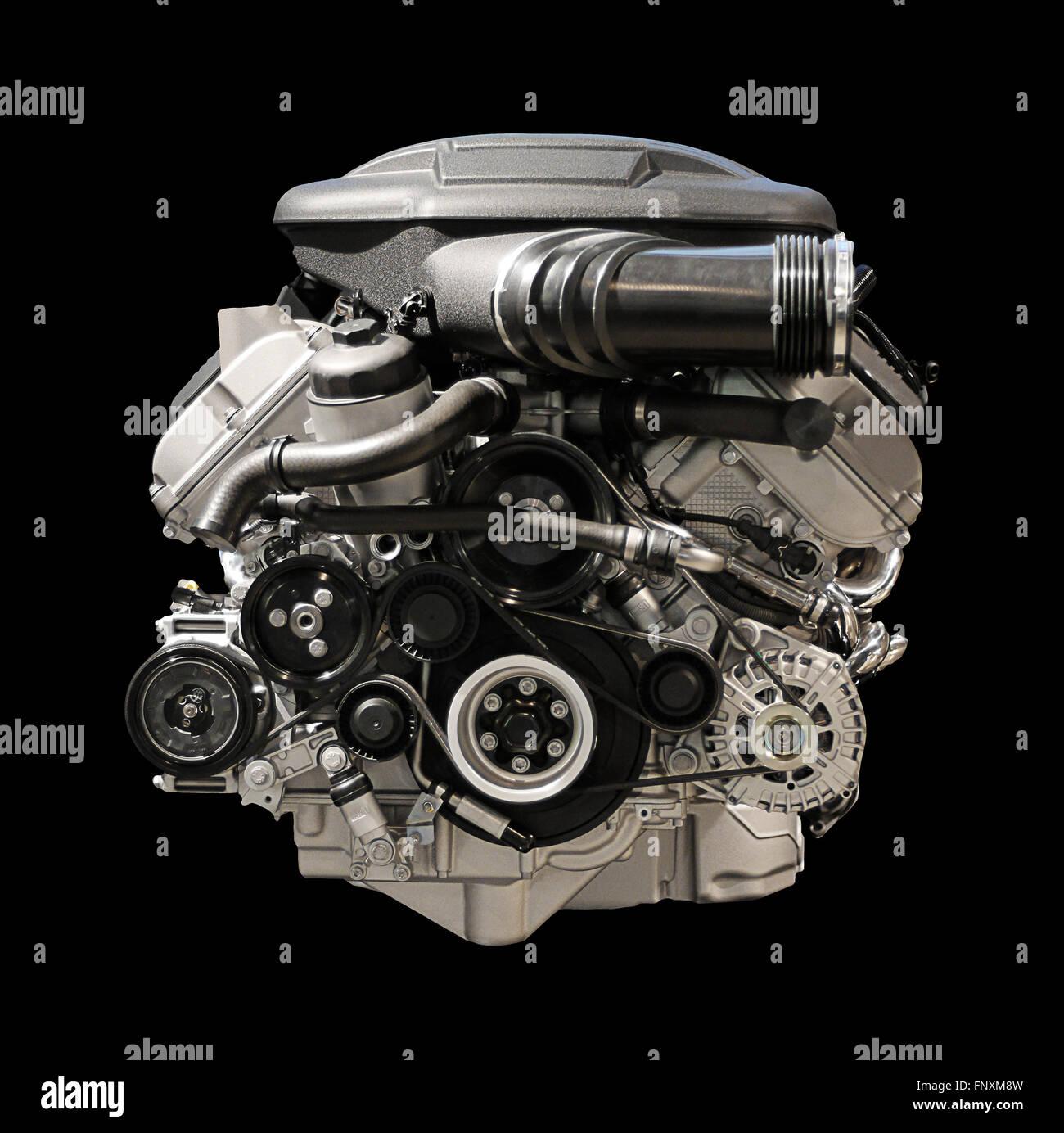Black and white photo of internal combustion engine isolated on black background Stock Photo