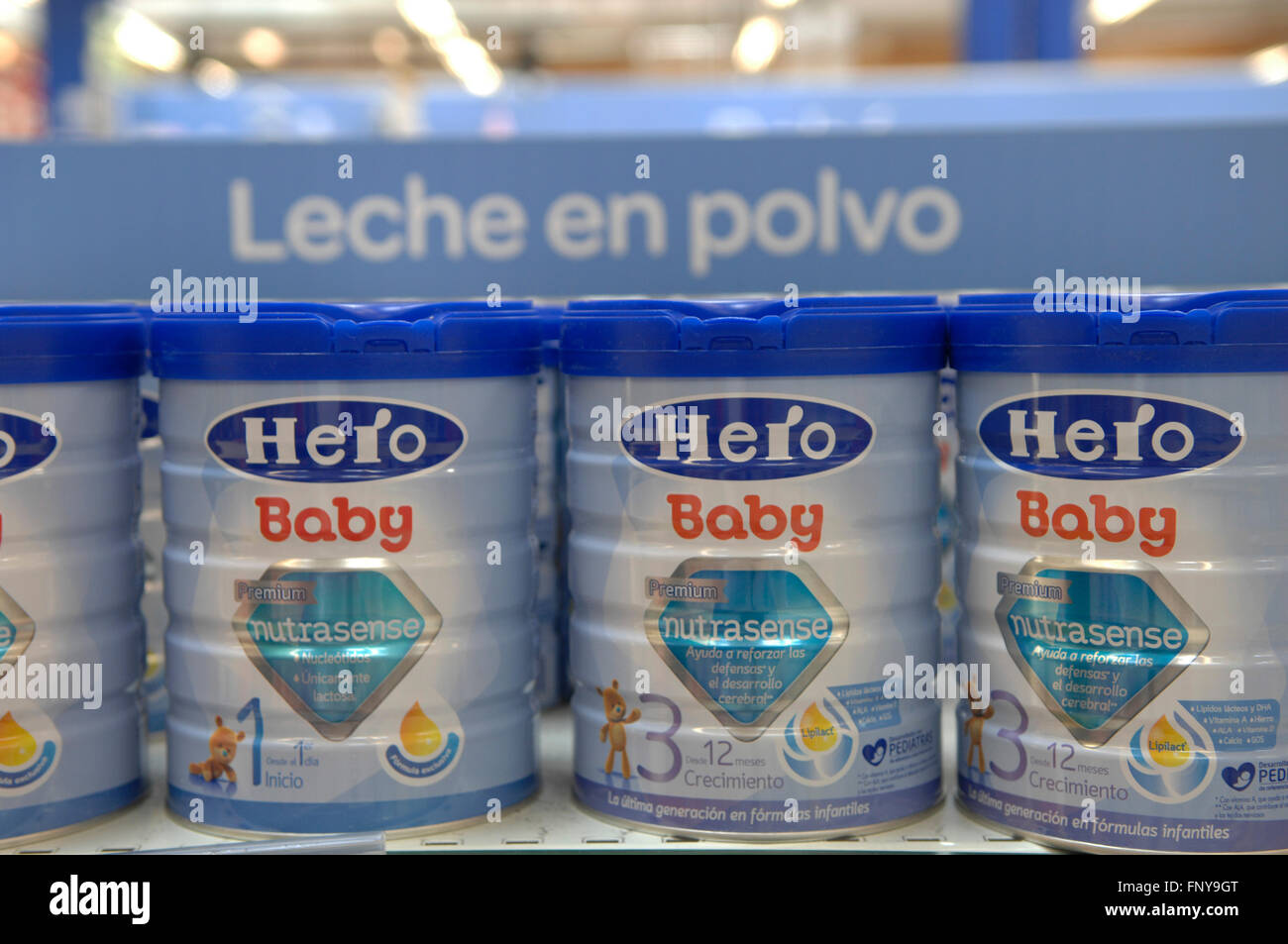 Hei'o Baby Milk Tins on sale in a Carrefour Supermarket in Malaga Spain. - Stock Image