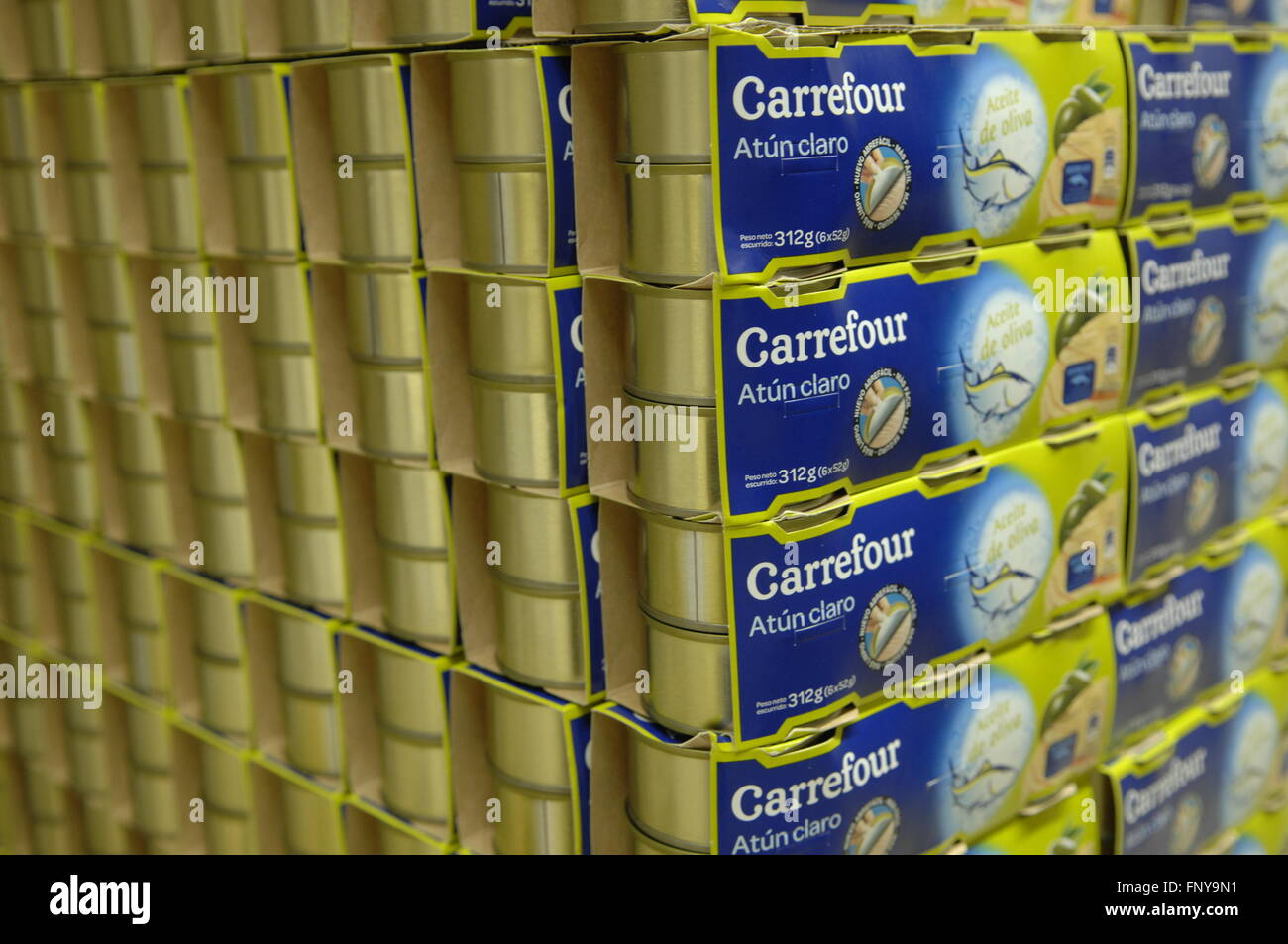 Carrefour own brand Tuna stacked in supermarket  Spain. - Stock Image