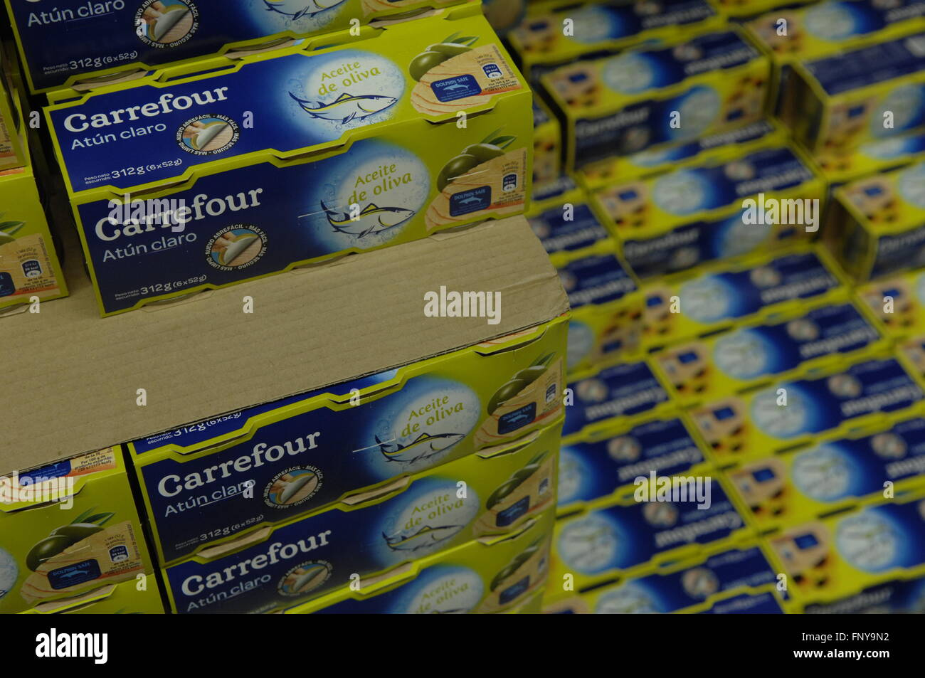 Carrefour own brand Tuna stacked in their Supermarket. - Stock Image