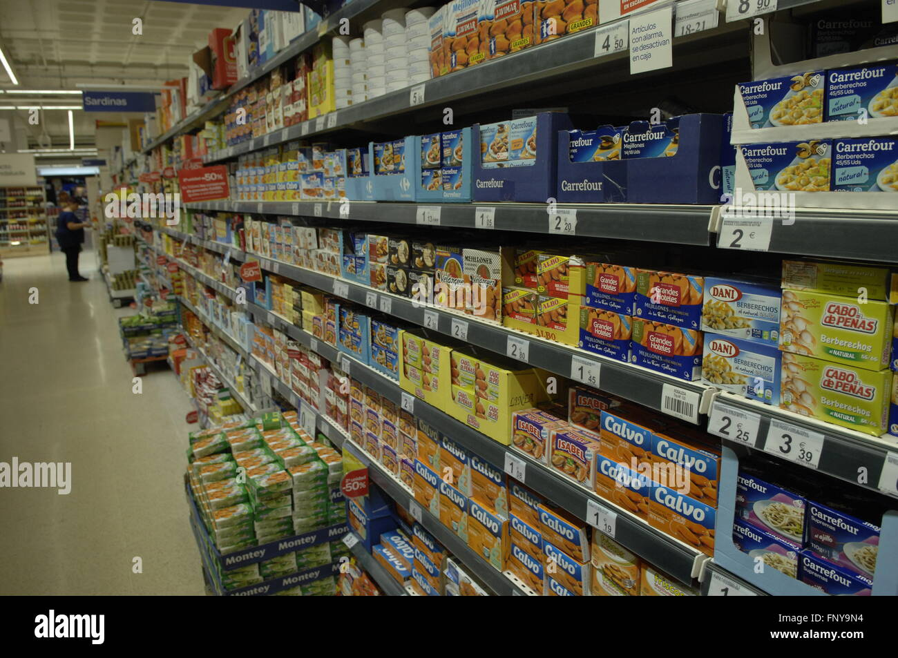 Carrefour Supermarket food aisle displaying products in Malaga Spain. Stock Photo