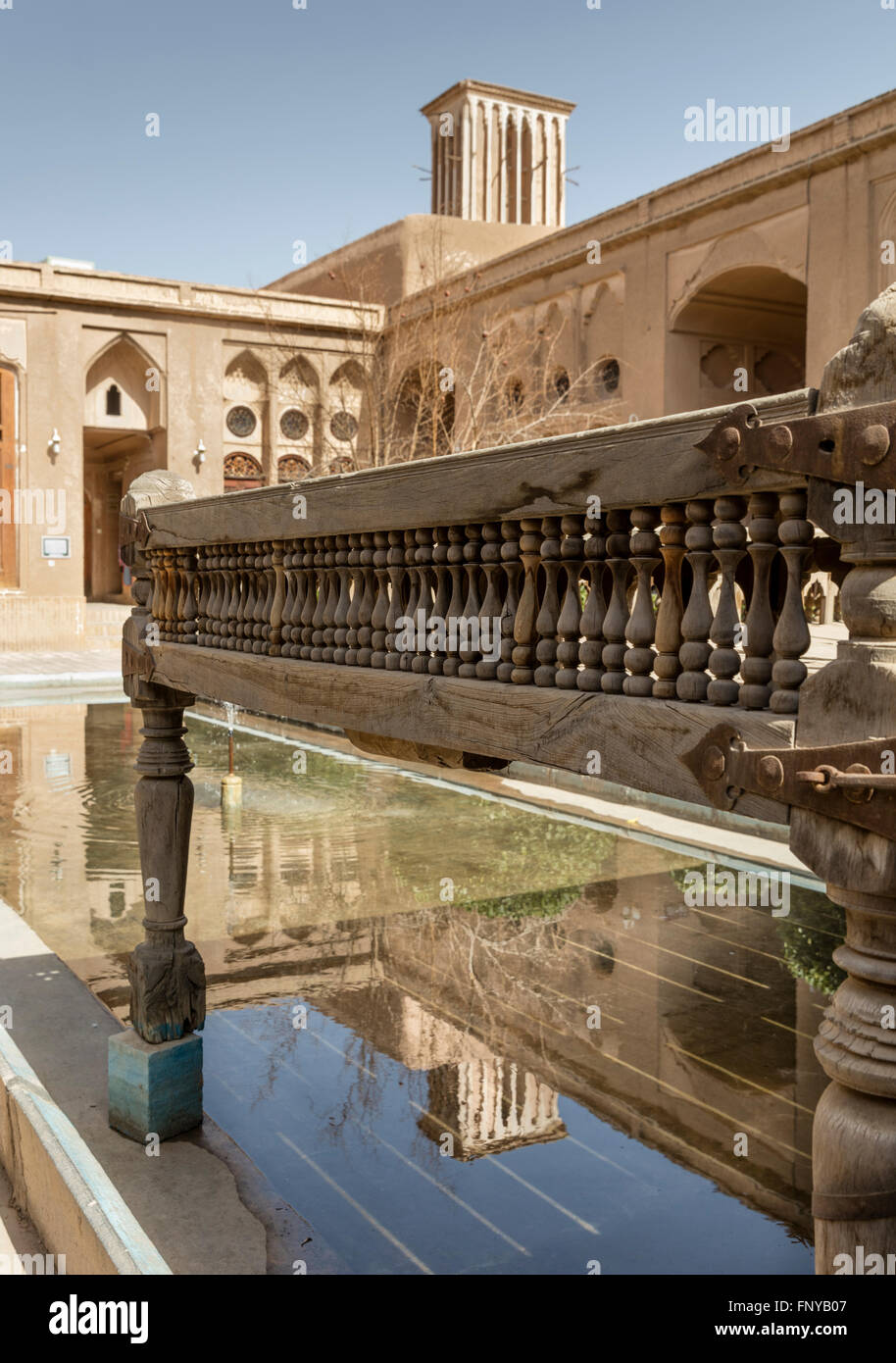 Courtyard, seating platform, wind tower, and reflecting pond of the 19th C Khaneh Lariha merchant's house, Yazd, - Stock Image
