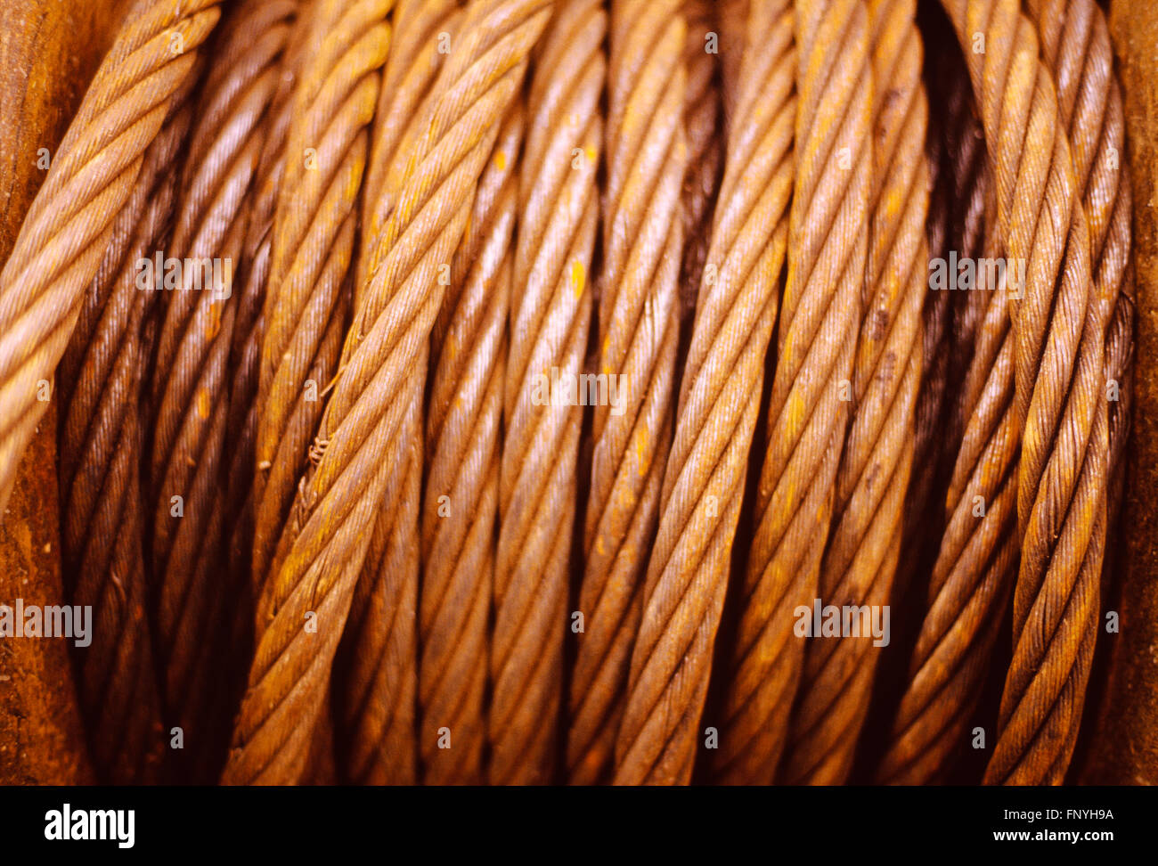 Rusty coiled steel metal winch cable - Stock Image