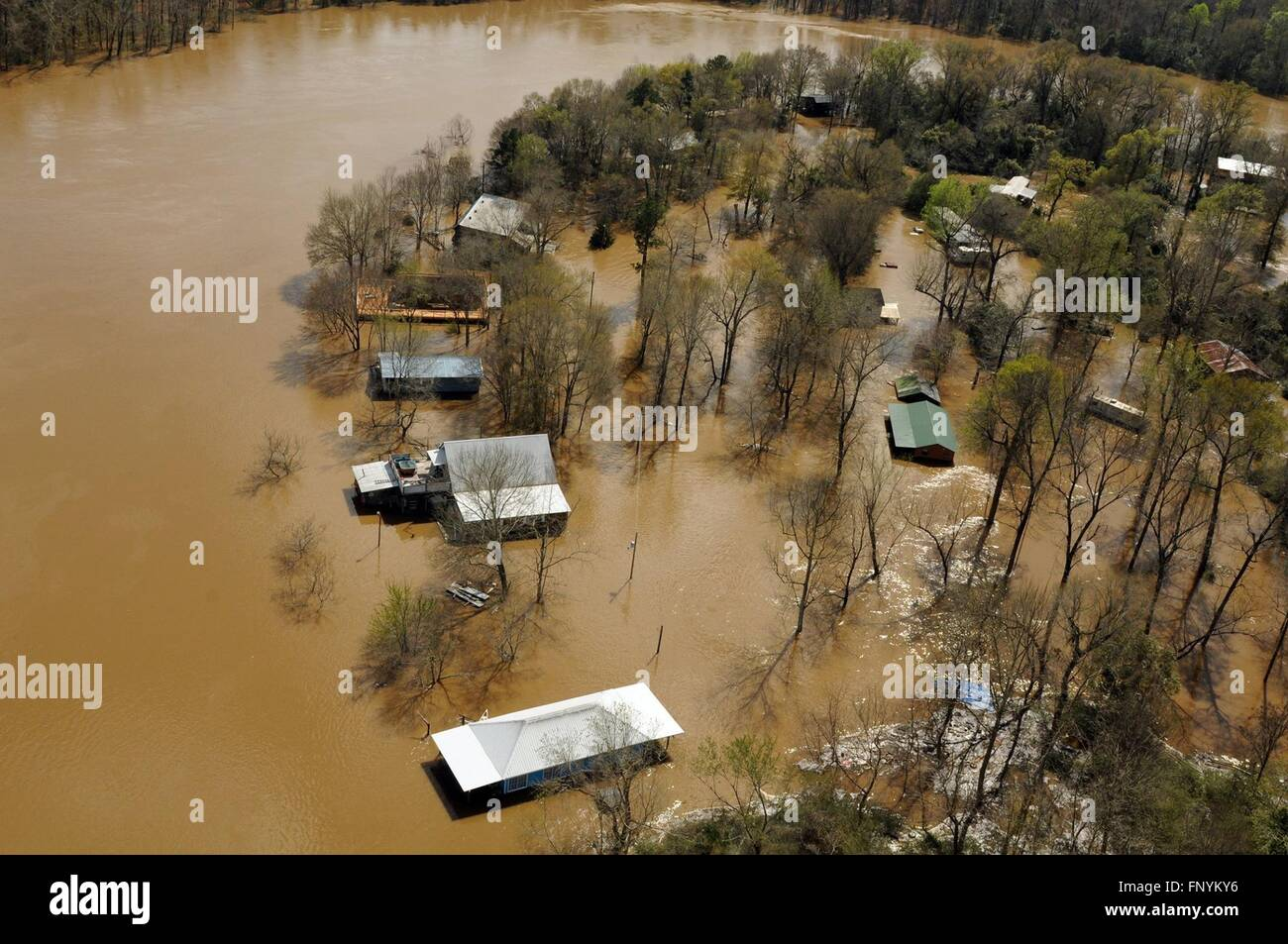 Aerial view of homes submerged in floodwaters along the Pearl and Leaf Rivers after record breaking storms dumped Stock Photo