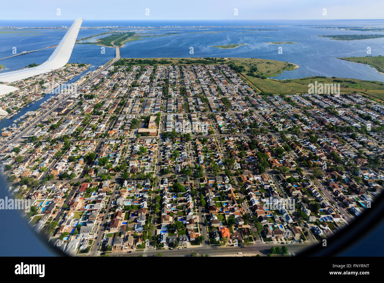 Aerial view of urban sprawl of New York City from approach to JFK airport - Stock Image