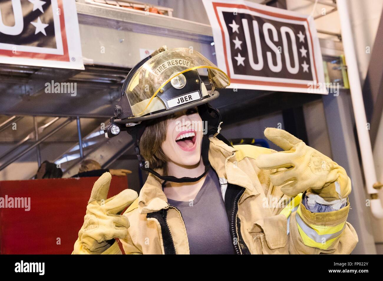 Betty Cantrell, Miss America 2016, tries on a firefighter uniform during a visit to service members as part of the - Stock Image
