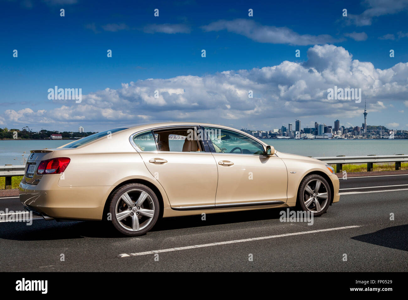 A Car Travelling Over The Auckland Harbour Bridge, Auckland, New Zealand - Stock Image