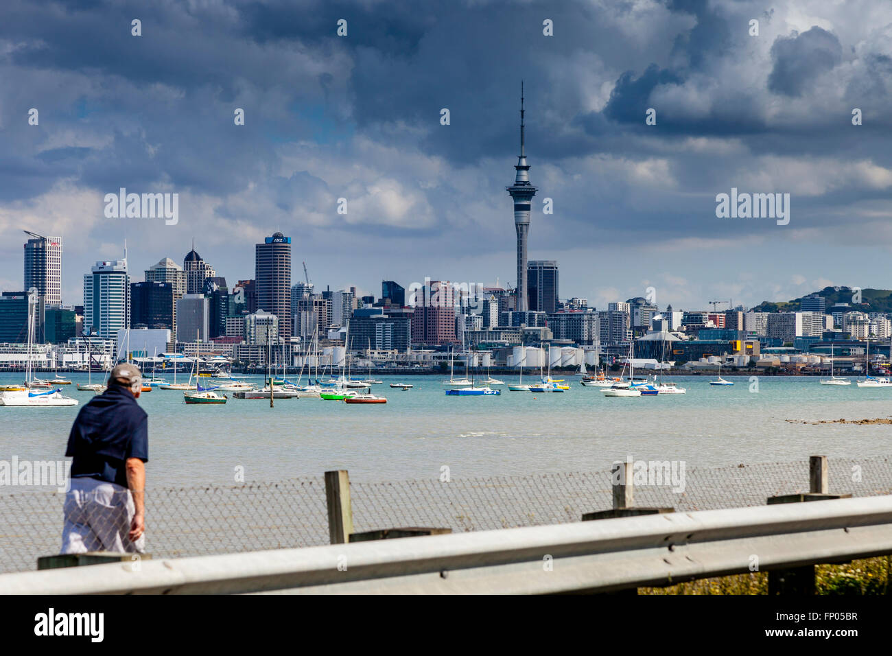An Elderly Man Walking Towards The Auckland Harbour Bridge, Auckland, North Island, New Zealand - Stock Image