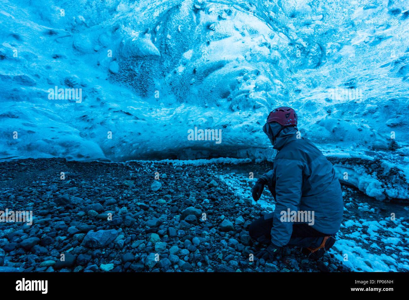 Man in an ice cave, Vatnajökull Nationalpark, Glacier, Iceland - Stock Image