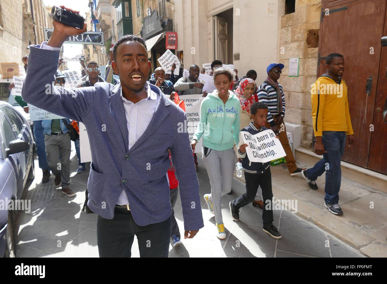 Valletta, Malta. 16 March, 2016. Ahmed Nuur Ibrahim, a Somali journalist, leads a peaceful protest through the streets - Stock Image