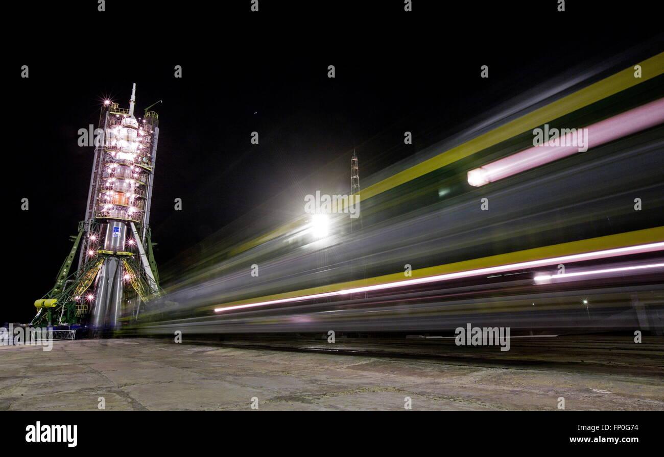 Kazakhstan, Baikonur. 16th Mar, 2016. The Soyuz FG booster rocket with the Soyuz TMA-20M spacecraft being installed - Stock Image