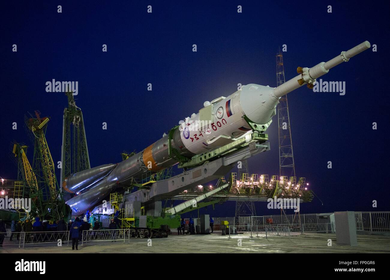 Baikonur, Kazakhstan. 16th Mar, 2016. The Soyuz TMA-20M spacecraft is raised into position on the launch pad at - Stock Image