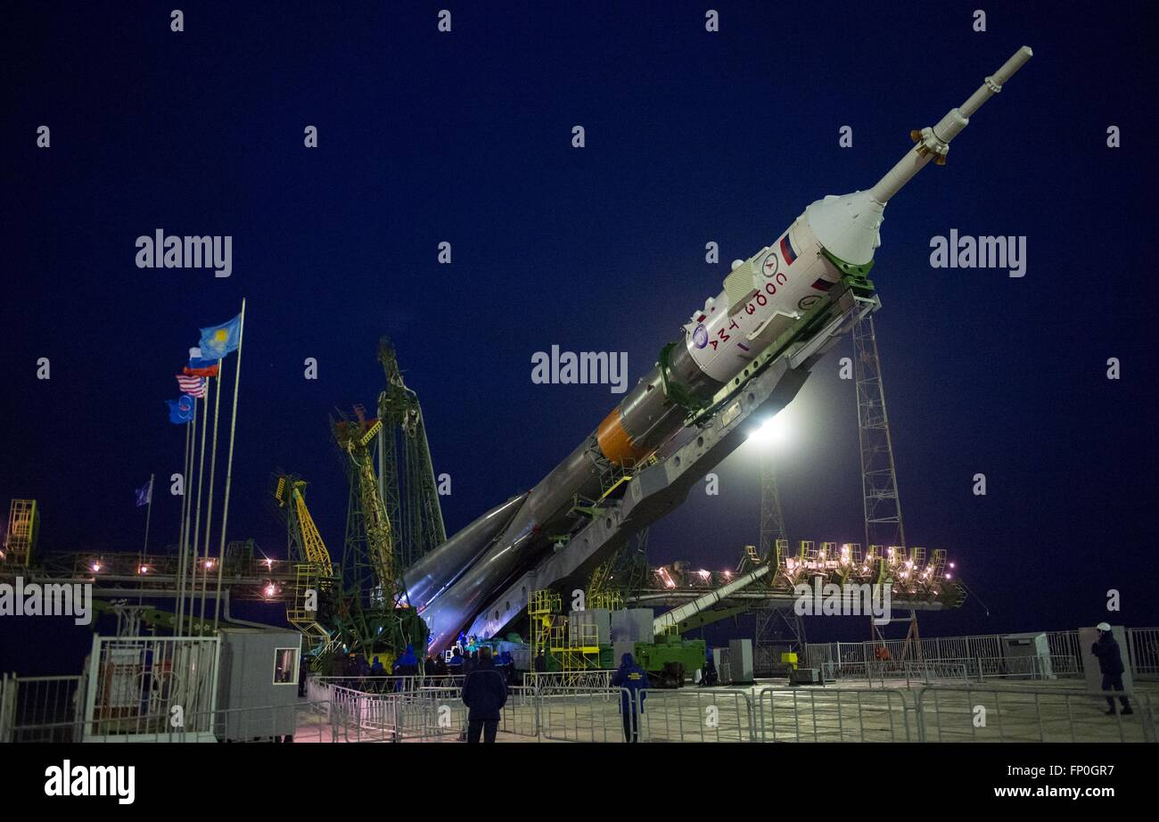 Baikonur, Kazakhstan. 16th Mar, 2016. The Soyuz TMA-20M spacecraft is raised into position on the launch pad at Stock Photo